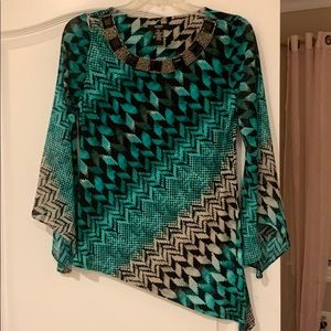 Dressy top great with black pants